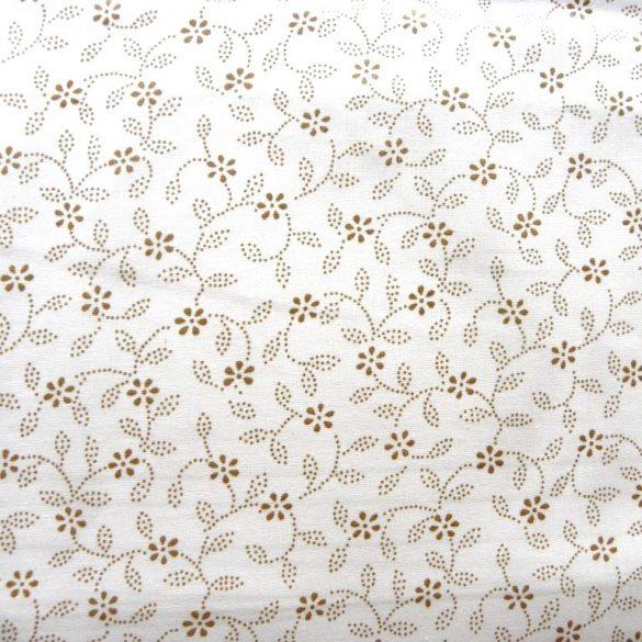 ILONKA, fehér alapon, drapp kékfestő mintás, leveles-virágos pamutvászon
